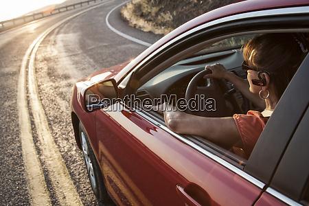 a senior woman at the wheel