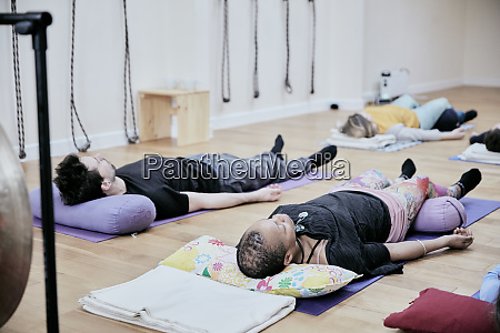 people lying down on an exercise