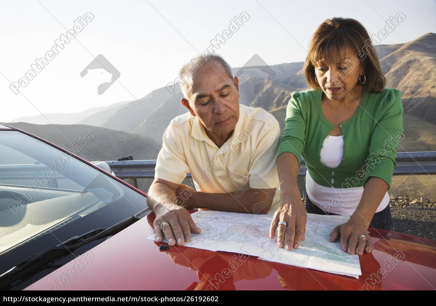 an, hispanic, senior, couple, checking, a - 26192602