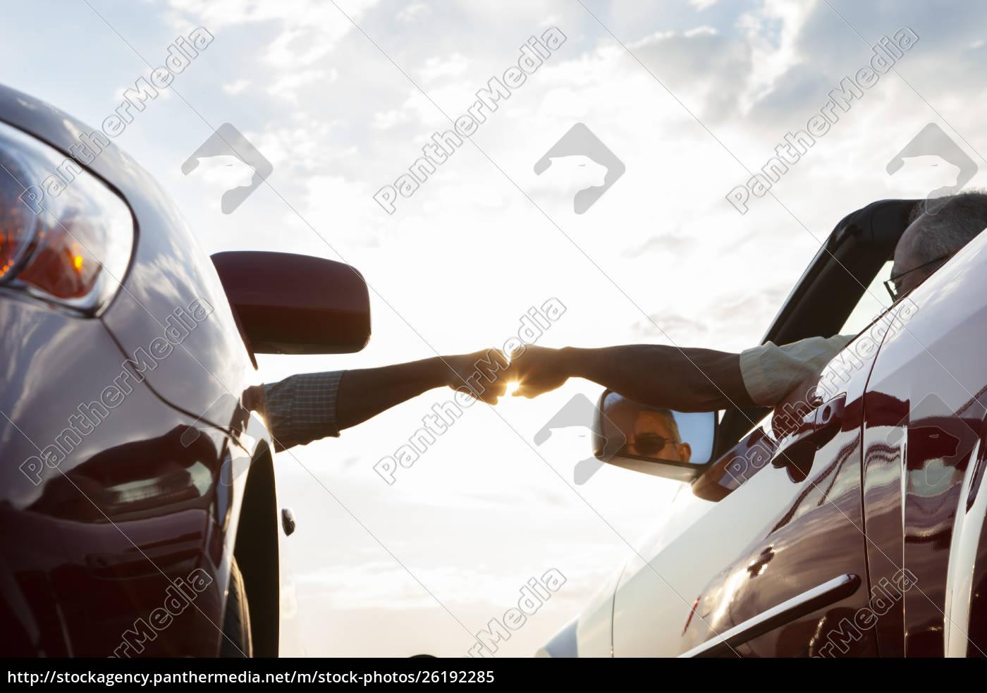 fist, bump, between, a, passenger, in - 26192285