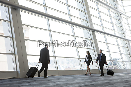 three, business, people, walking, next, to - 26192524
