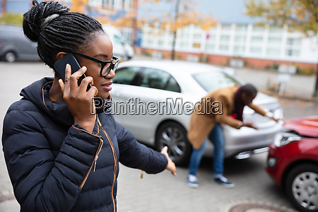 woman calling for assistance after car