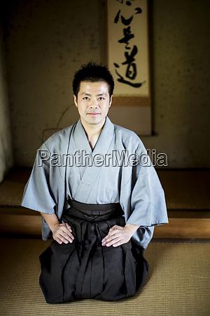 japanese man wearing kimono sitting on