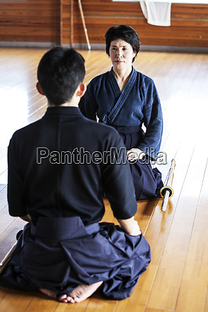 female and male japanese kendo fighters