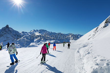 people on sunny slope at 3