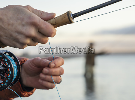 a closeup of a fly fishermans