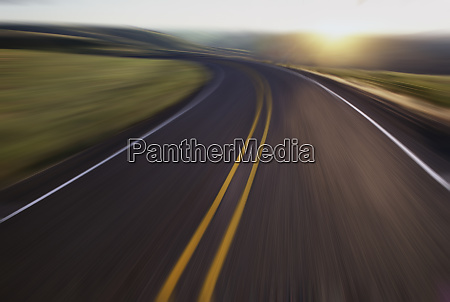 blurred view of a highway the