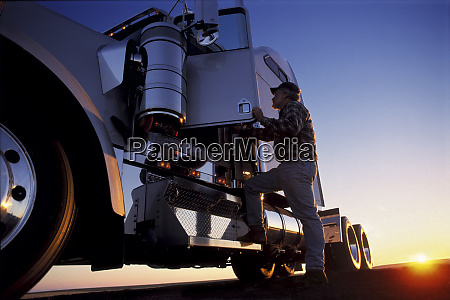 a silhouette of a truck driver