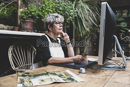 senior woman wearing glasses black top