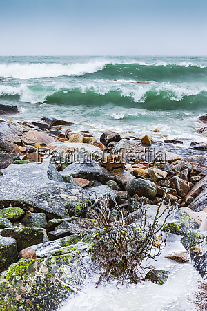 stormy waves crashing into the shore