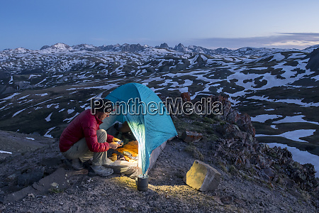 a man camping with a tent