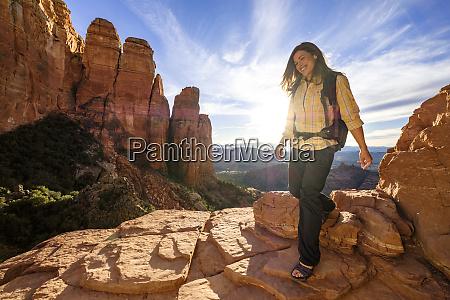 female hiker walking down rocks at