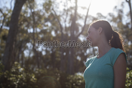adult woman catching breath while running
