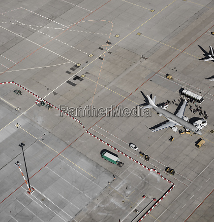 aerial view of passengers boarding commercial