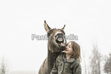 playful girl and donkey
