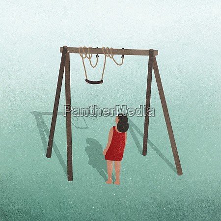 girl looking up at tangled swing