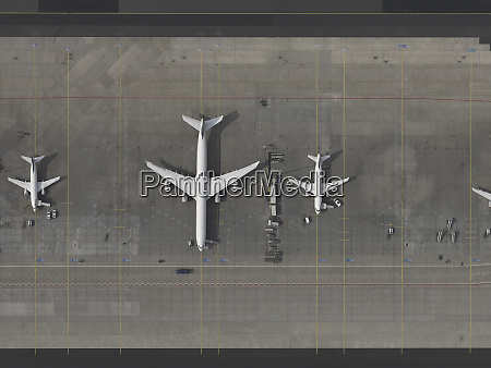 aerial view airplanes parked on tarmac