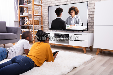 couple watching television at home