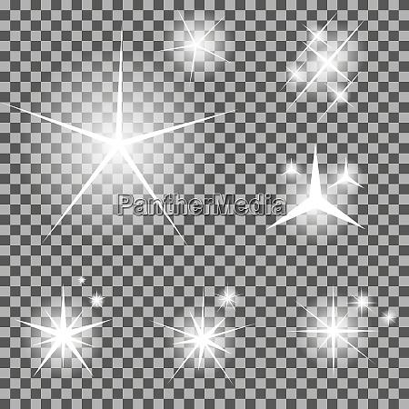 set von leuchtenden lichtsterne mit funkelnden