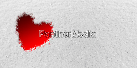 red heart in front of snow