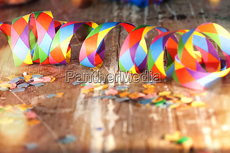 confetti and streamers on old wood