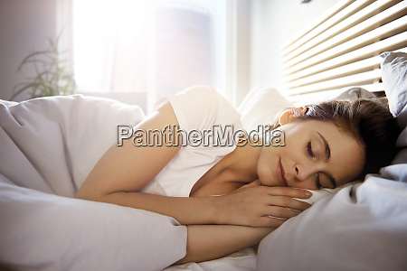 portrait of young woman sleeping in