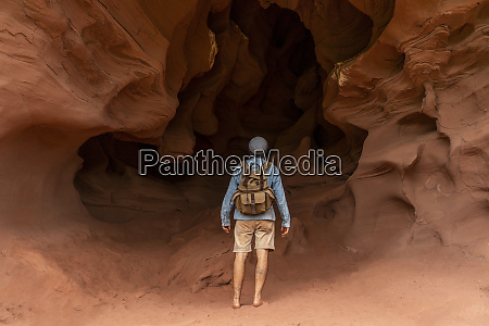 young man with backpack looking at