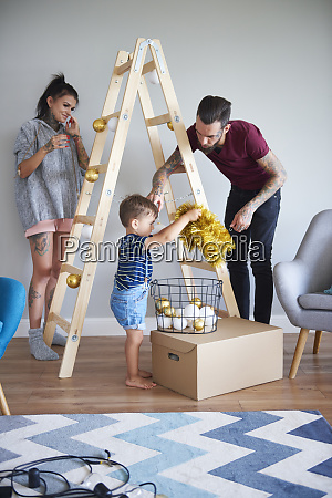 modern family decorating the home at