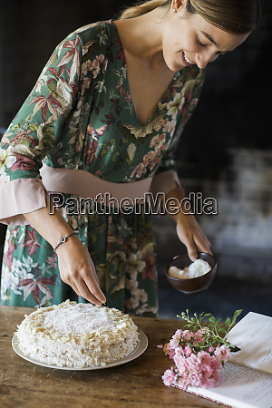 smiling young woman garnishing home baked
