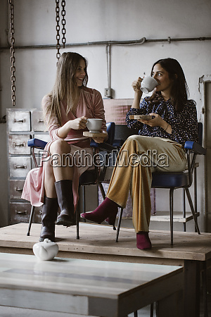 two friends drinking tea together in