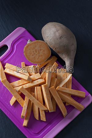 sliced and whole sweet potato