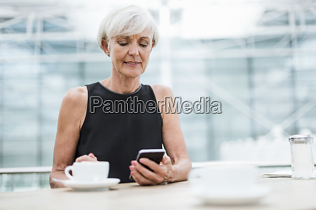 senior woman using cell phone in