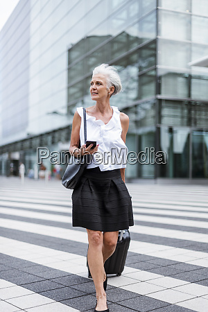 senior woman with cell phone and