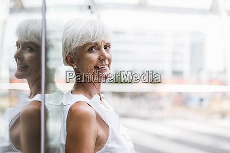 portrait of smiling senior woman leaning