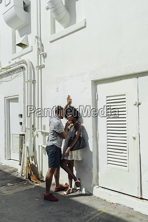 smiling affectionate young couple standing at