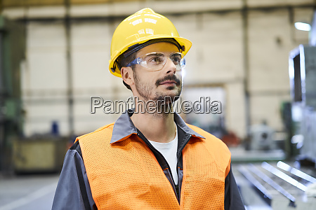 man wearing protective workwear looking around