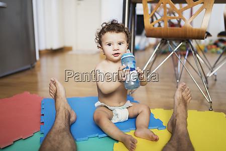 portrait of baby boy wearing diaper