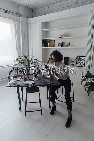 mid adult woman working in her