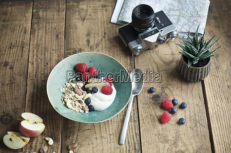 breakfast bowl with granola yogurt nuts