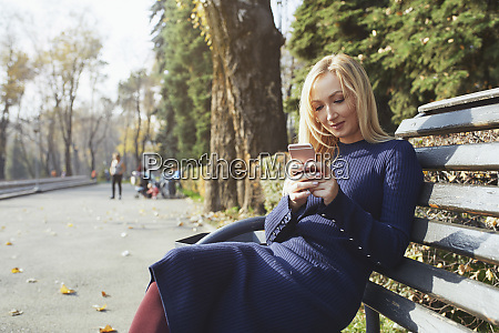 portrait of blond woman sitting on