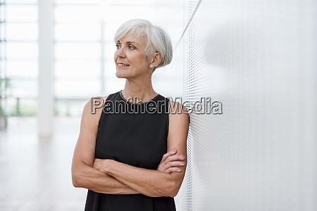 senior woman wearing black dress leaning