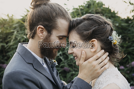 happy affectionate bride and groom outdoors