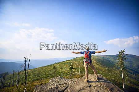 rear view of hiker in mountains
