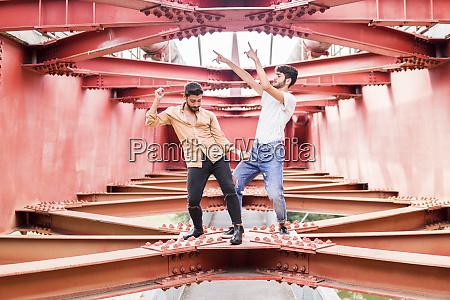 young gay couple dancing on steel