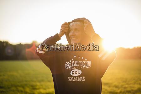 smiling senior woman wearing a hoodie