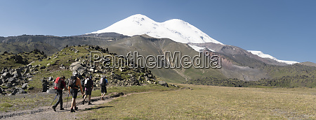 russia caucasus mountaineers hiking in upper
