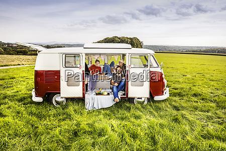 friends having picnic in a van