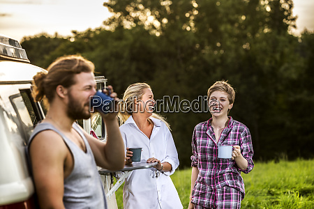 carefree friends enjoying coffee at a