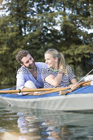 happy young couple enjoying a canoe