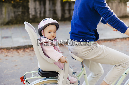 mother and daughter riding bicycle baby
